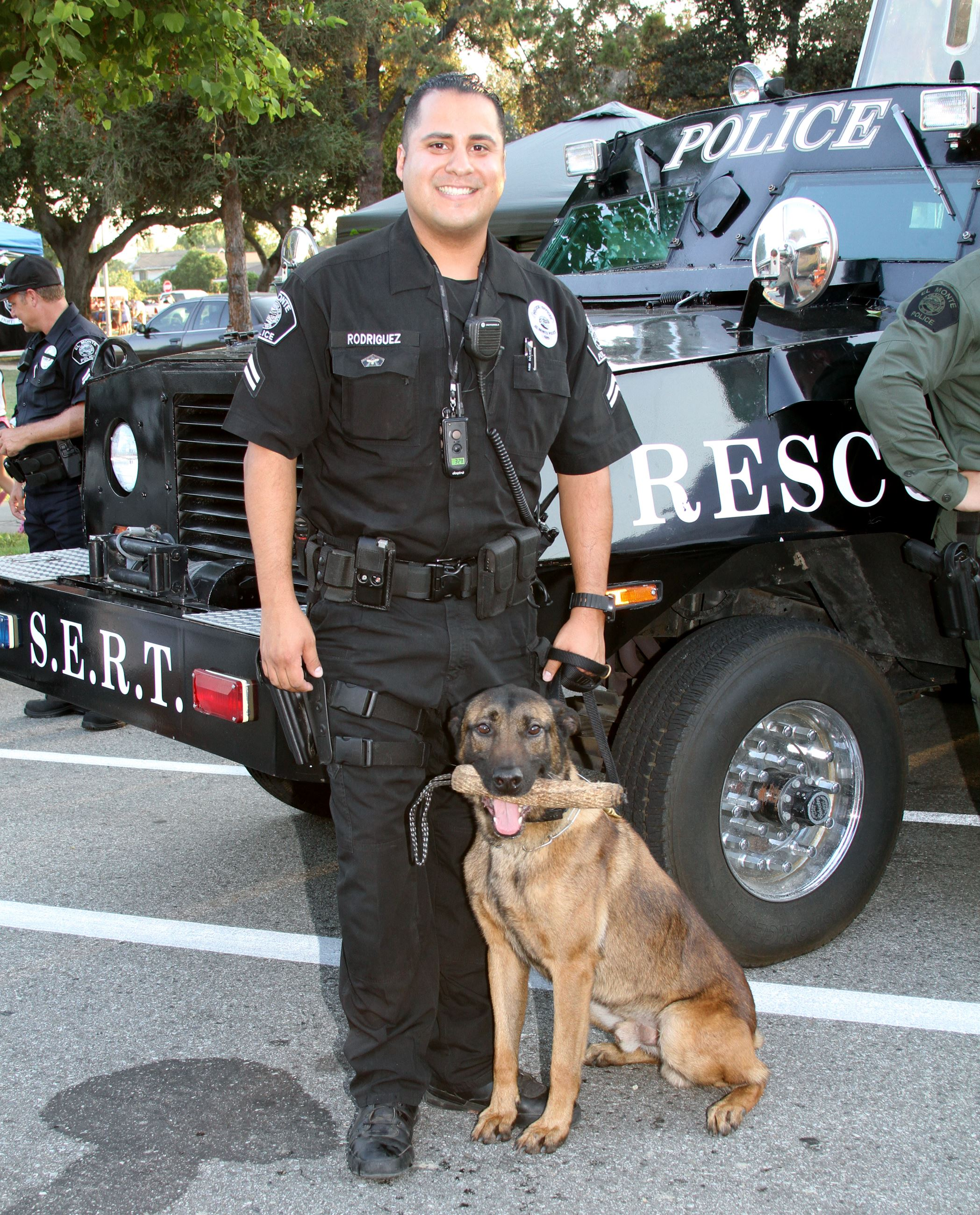 Officer Stands with Dog Officer from Canine Unit