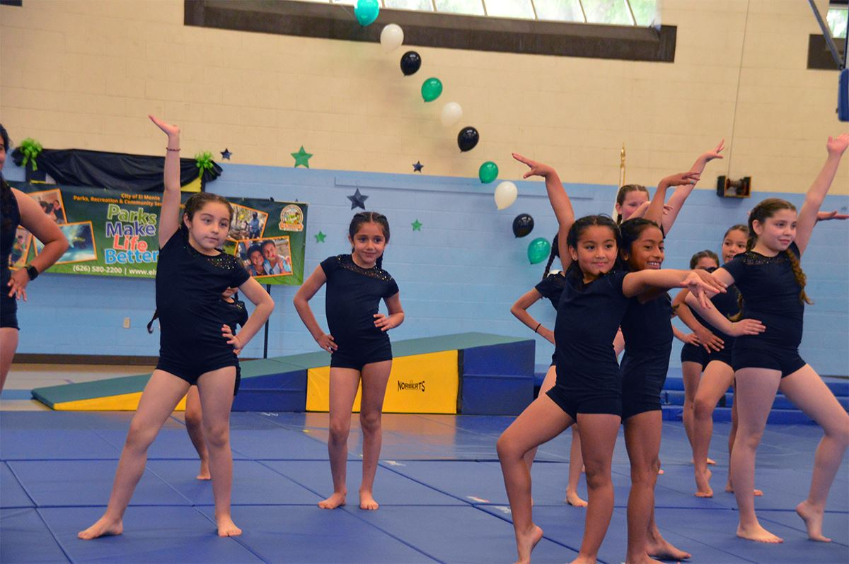 Girls posing during gymnastics class
