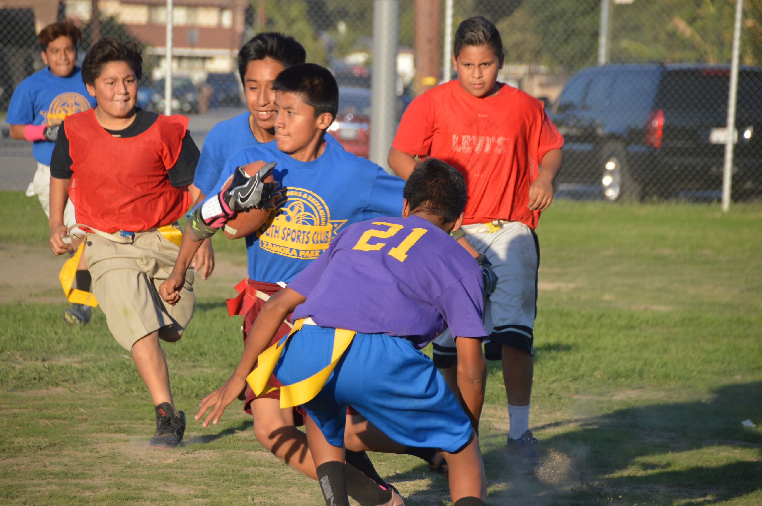 Children participating in the Teen Flag Football Club